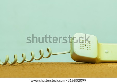 old phone on the table. - stock photo