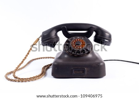 Old phone on white background - stock photo