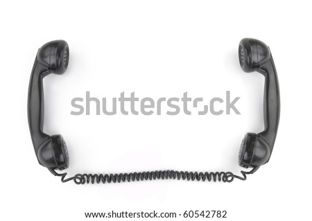 Old phone receiver on white background - stock photo