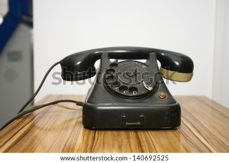 old phone telephone on old table