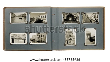 Old photo album with (new) photos from Venice, Italy. - stock photo