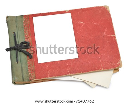 Old photo album with photos isolated on white. - stock photo