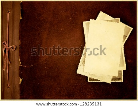 Old photo album with several photos on it. - stock photo