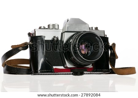 Old photo camera in cover, on white background - stock photo