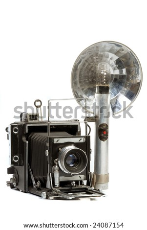 Old  Photo camera with bulb flash - stock photo