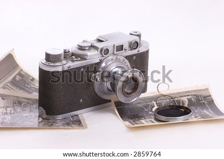 old photo camera with some retro photos - stock photo