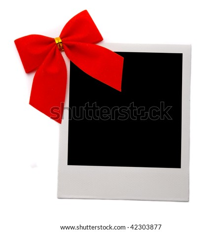 Old photo card with red bow isolated on a white background - stock photo