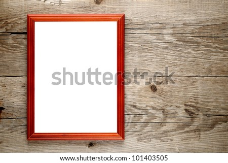 Old photo frame on wooden background - stock photo