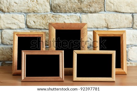 old photo frames on the wooden table - stock photo