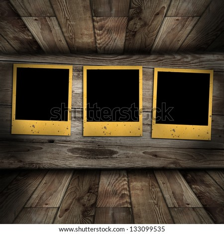 Old photo frames on wooden background - stock photo