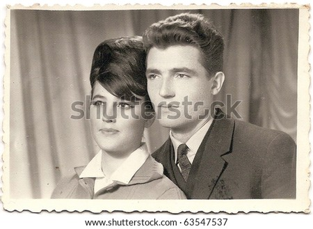 old photo of a handsome couple - stock photo