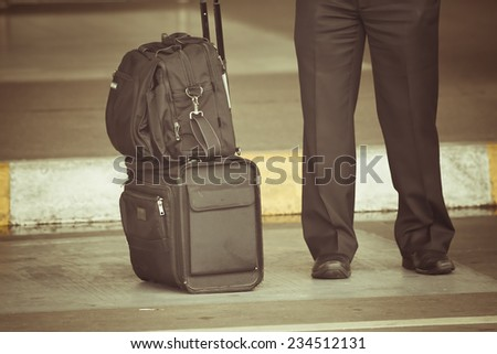 old photo of pilot carries his luggage at the airport terminal - stock photo