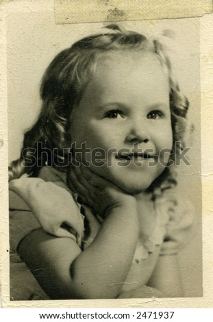 Old photo of pretty little girl - stock photo