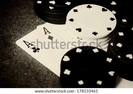 old photo of two aces with casino chips - stock photo