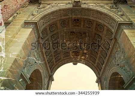Old photo with architectural details at Arc de Triomphe du Carrousel in Paris, France. Image digitally manipulated as one old photo. - stock photo