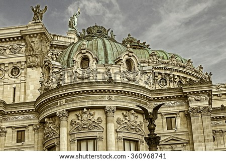 Old photo with architectural details of Opera National de Paris: Front Facade. Grand Opera (Garnier Palace) is famous neo-baroque building in Paris - UNESCO World Heritage Site. Vintage processing. - stock photo