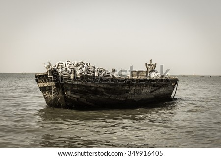 Old photoof old fishing boats in sea. - stock photo