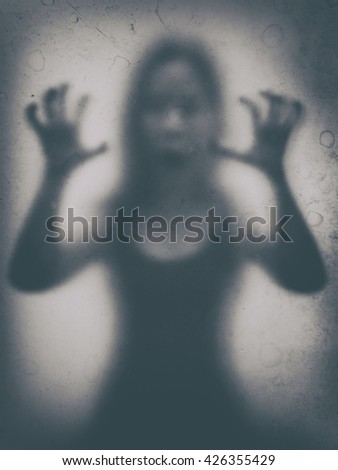 Old Photos A woman shows a ghost haunts (Vignette old and archaic concept .) - stock photo