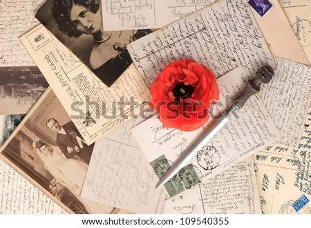 old photos and post cards with letter opener. vintage grunge background - stock photo