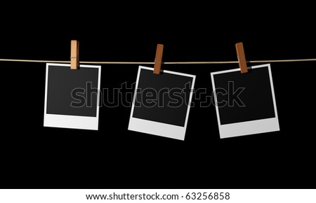 Old photos hanging on a rope - stock photo