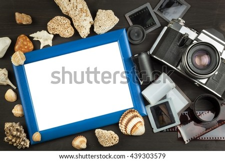 Old photos of the seaside holiday. The old camera. Memories of the sea. Family album photos. Memories of youth. Greetings from the seaside holiday. Equipment artistic photographer. - stock photo