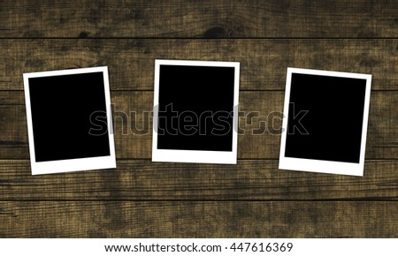 Old photos on distressed wood background. 3D rendering - stock photo
