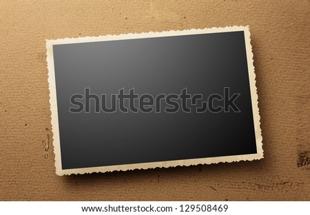 old photos on gray cardboard background - stock photo