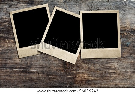 old photos on wooden background