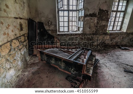 old piano in an abandoned villa