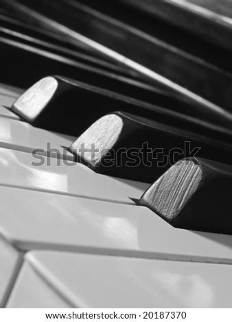 old piano keyboard fragment in evening light - stock photo