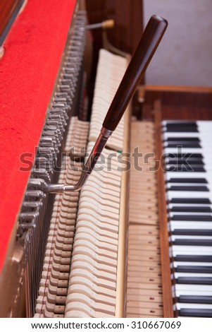 Old piano keyboard. White and black keys in perspective.