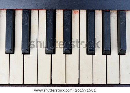 Old Piano keys viewed from above - stock photo