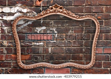 Old picture frame a a grunge red brick wall - stock photo