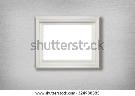 Old picture frame hanging on wall - stock photo