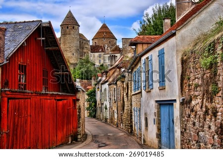 Old picturesque lane with medieval towers in the village of Semur en Auxois, Burgundy, France         - stock photo
