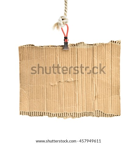 old piece of cardboard on rope for message - stock photo