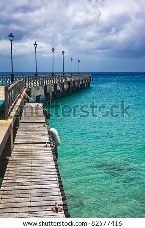 Old pier in Speightstown in the Caribbean island of Barbados - stock photo