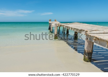 Old pier on a very beautiful beach, in Coche Island, in the Caribbean Sea - stock photo