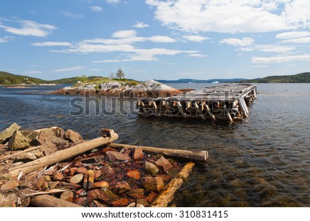 Old pier with damage. - stock photo