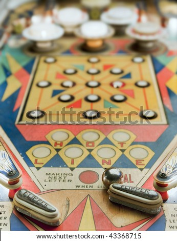 Old pinball playng - stock photo
