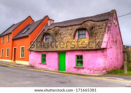 Old pink cottage house in Ireland - stock photo