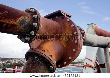 Old pipes on the top of old cement silo in Port of Auckland - stock photo