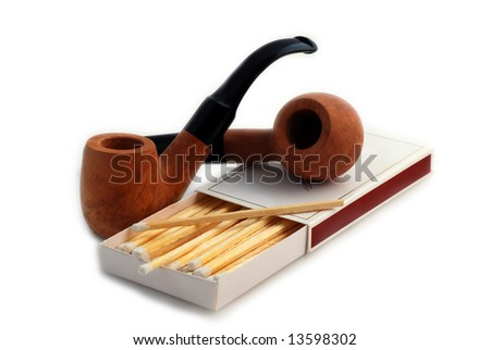 old pipes with closeup of white tipped wooden match sticks in a match box isolated in white