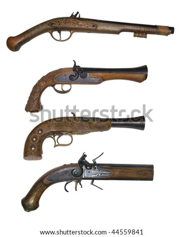 Old pistols isolated on white