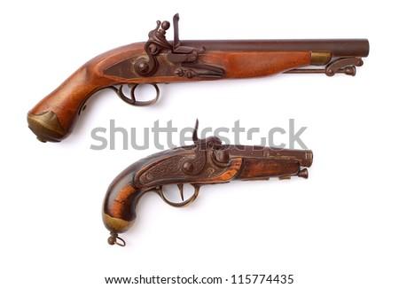 Old pistols isolated on white background - stock photo