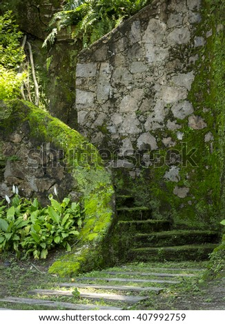 old place decorated in green areas - stock photo
