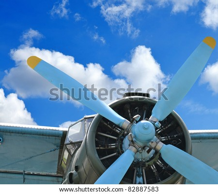 Old plane against blue sky, vintage background, close up - stock photo