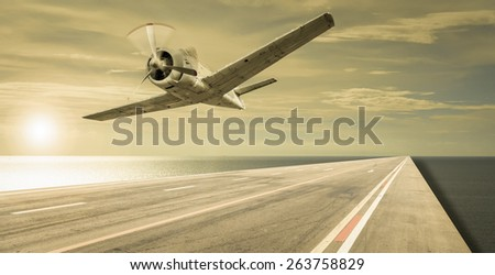 old plane over the sea - stock photo