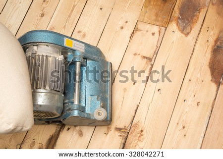 old plank floor and grinding machine with copy space - stock photo