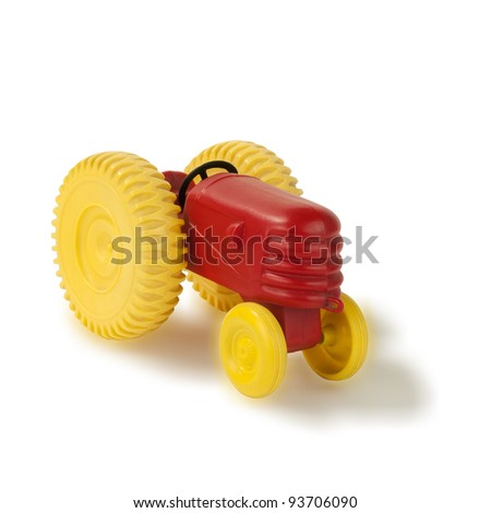 old plastic toy tractor front isolated